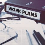 Work Plans - Office Folder on Background of Working Table with
